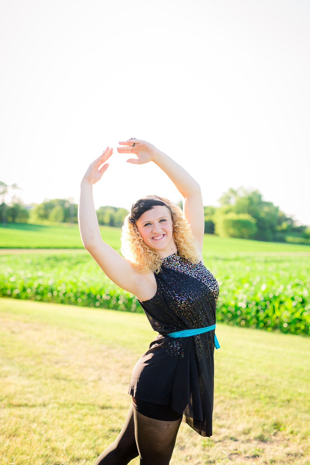 Outdoor, Country Styled High School Senior Pictures by Amber Langerud Photography | Audubon, MN | HS senior dancer ballet pose