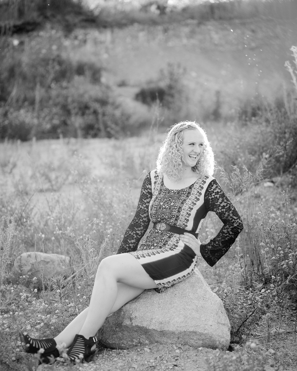 Outdoor, Country Styled High School Senior Pictures by Amber Langerud Photography | Audubon, MN | Senior Sitting on Large Rock