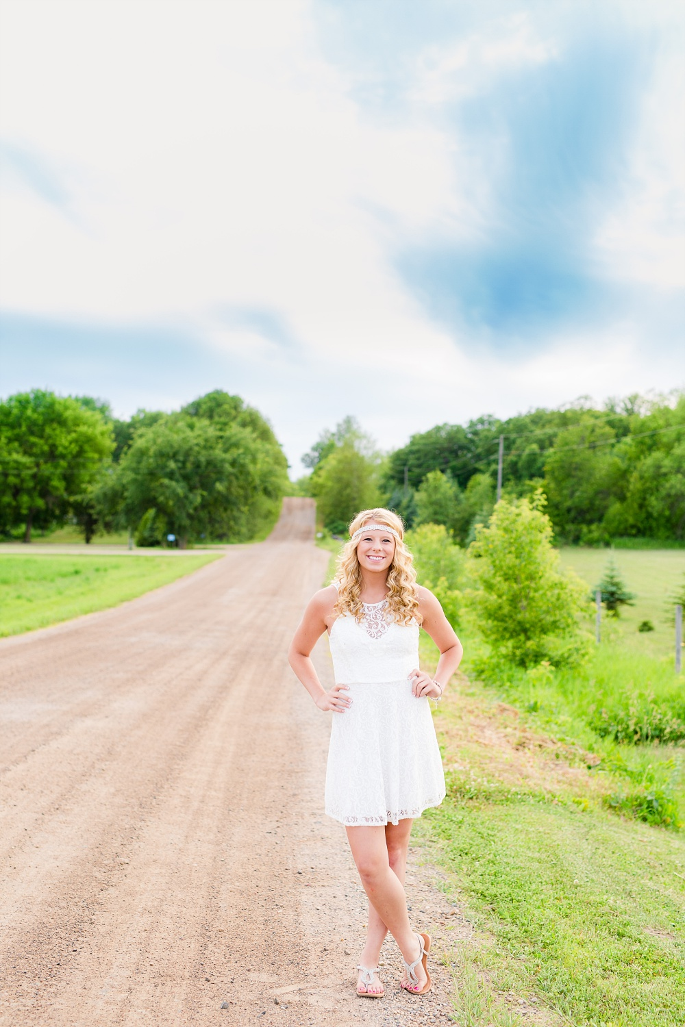 Outdoor, country and basketball styled senior pictures near Audubon, MN | Amber Langerud Photography | wearing white dress on gravel road