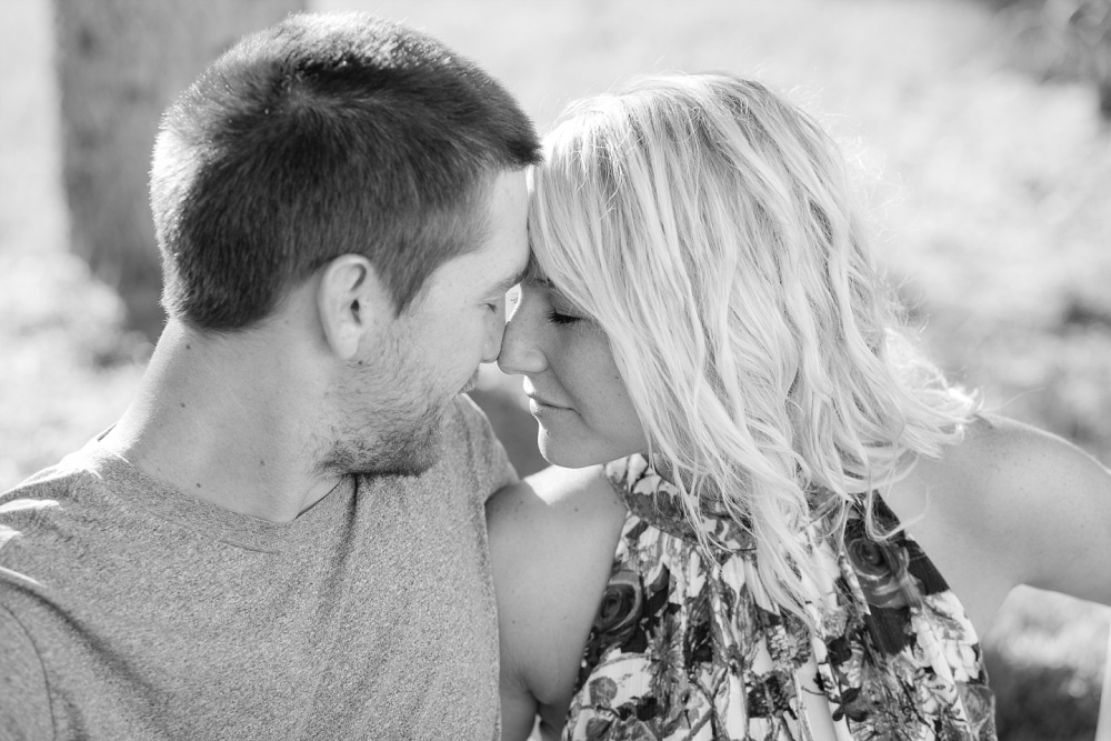 Outdoor, Country Styled Engagement Session with Their Puppy near Audubon, MN | Amber Langerud Photography | Couple wiggling noses