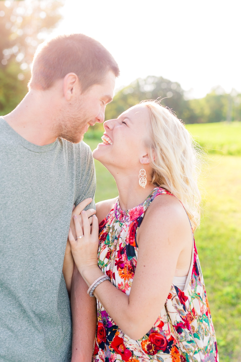 Outdoor, Country Styled Engagement Session with Their Puppy near Audubon, MN | Amber Langerud Photography | Couple laughing at each other
