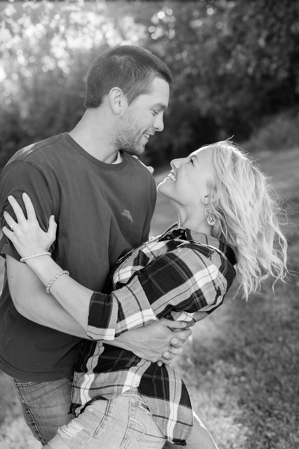 Outdoor, Country Styled Engagement Session with Their Puppy near Audubon, MN | Amber Langerud Photography | Couple Dipping