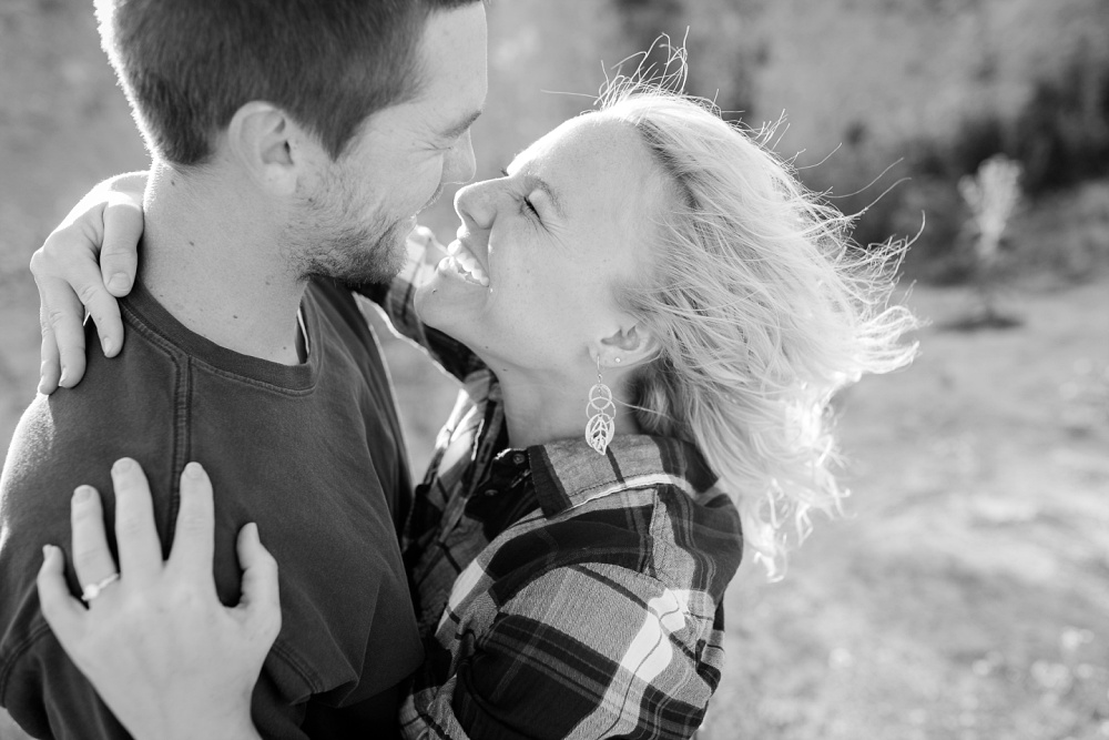 Outdoor, Country Styled Engagement Session with Their Puppy near Audubon, MN | Amber Langerud Photography | Couple almost kissing