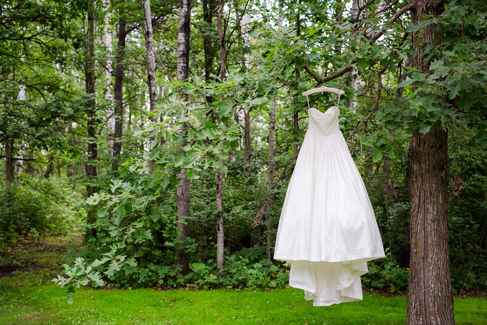 Wolf Lake, MN Country Styled Wedding, White Dress, Blue Suite | Photographed by Amber Langerud Photography | White wedding dress on oak tree
