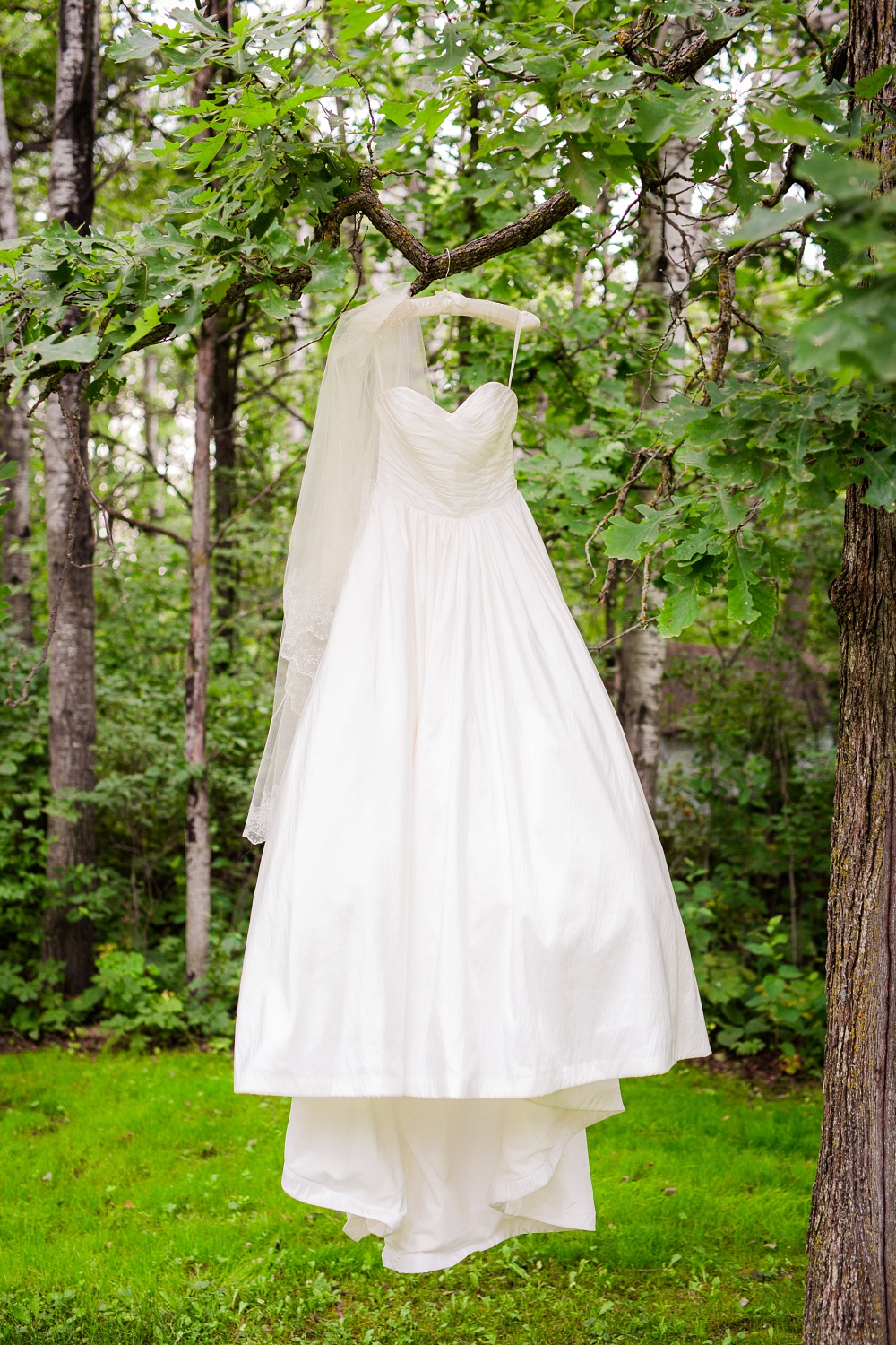 Wolf Lake, MN Country Styled Wedding, White Dress, Blue Suite | Photographed by Amber Langerud Photography | Wedding Dress & Veil Outside