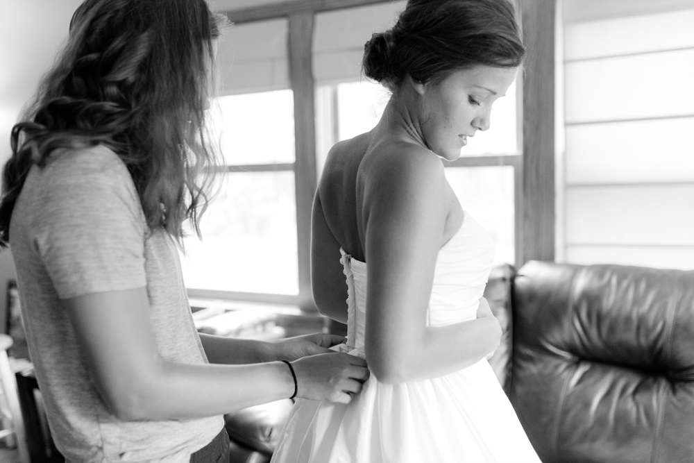Wolf Lake, MN Country Styled Wedding, White Dress, Blue Suite | Photographed by Amber Langerud Photography | Putting on the dress