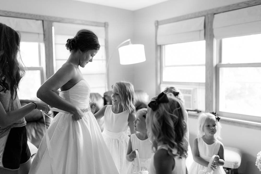 Wolf Lake, MN Country Styled Wedding, White Dress, Blue Suite | Photographed by Amber Langerud Photography | flower girls admiring the bride