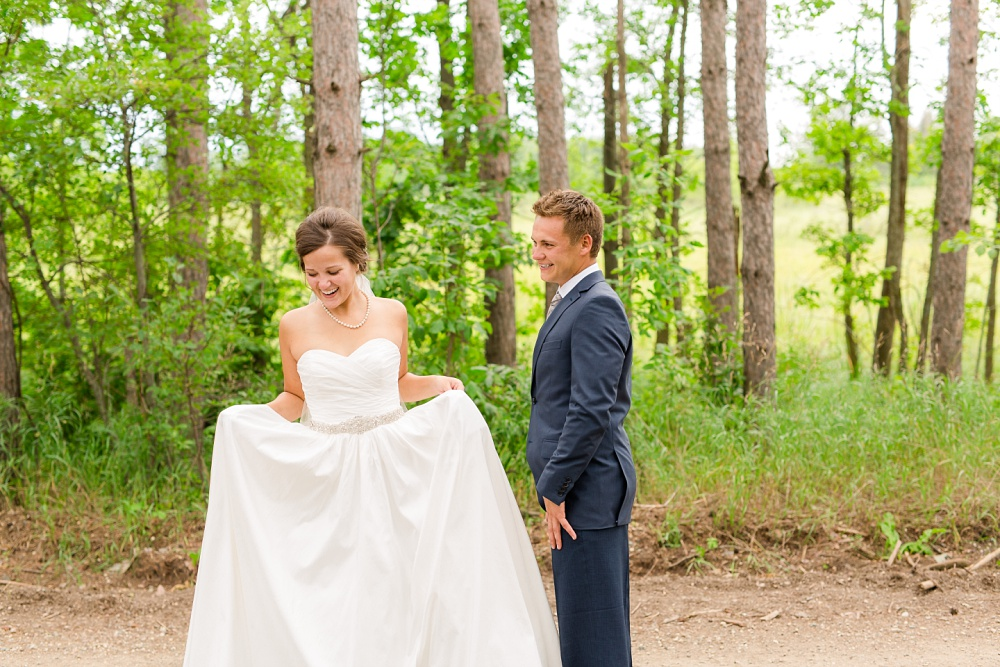 Wolf Lake, MN Country Styled Wedding, White Dress, Blue Suite | Photographed by Amber Langerud Photography | A wedding dress with pockets