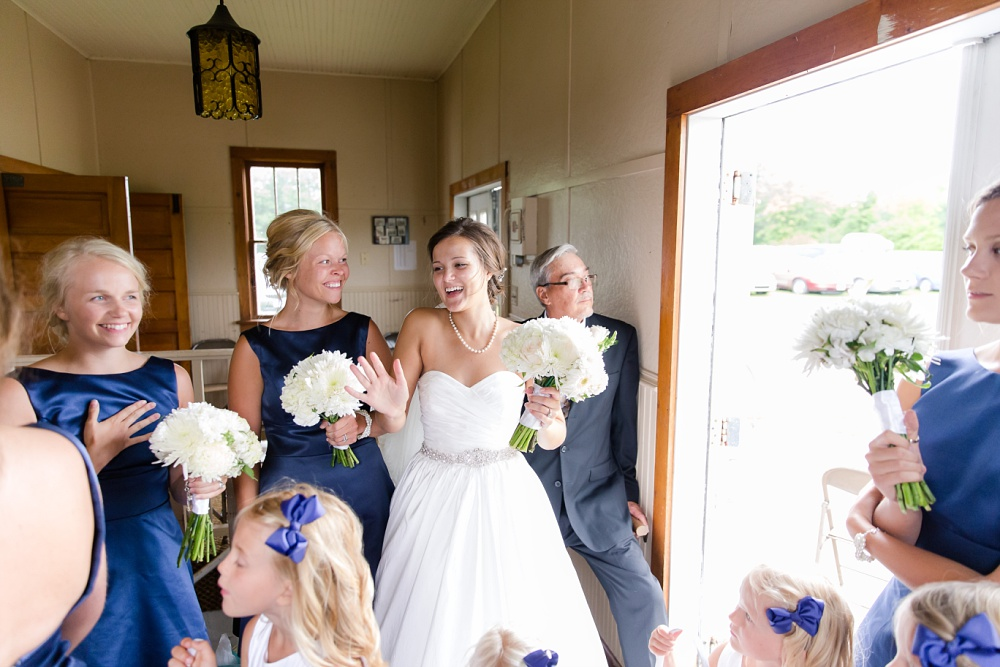 Wolf Lake, MN Country Styled Wedding, White Dress, Blue Suite | Photographed by Amber Langerud Photography | Getting Ready to Walk Down the Isle