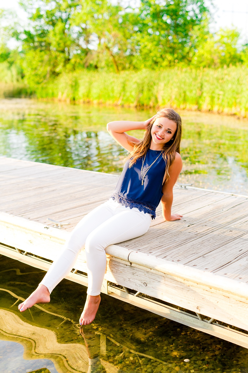 Country Styled High School Senior Portraits in Detroit Lakes, MN | Photographed by Amber Langerud Photography | Sitting on Dock on Little Cormorant Lake