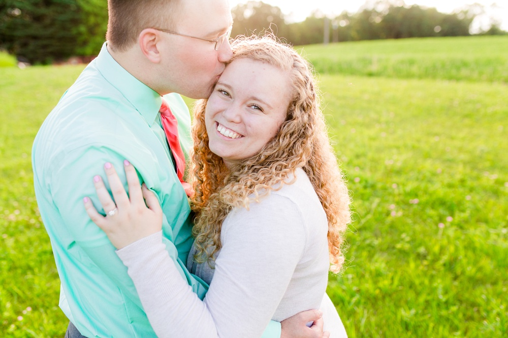 Minnesota Country Styled Engagement Pictures by Amber Langerud Photography | Kissing fiance on forehead, sunglow