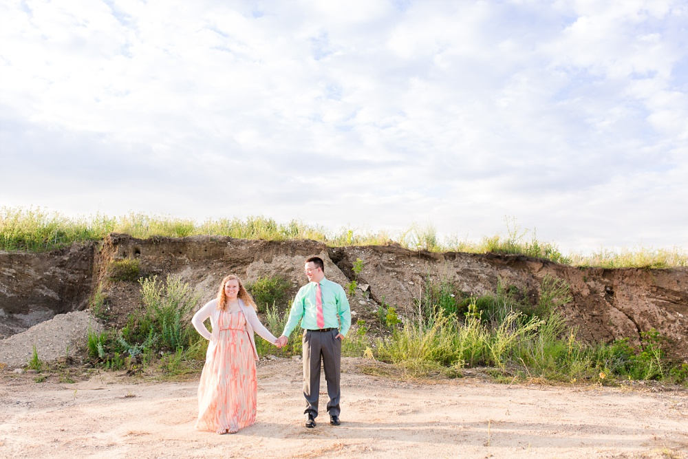 Minnesota Country Styled Engagement Pictures by Amber Langerud Photography | Couple standing under cloudy sky