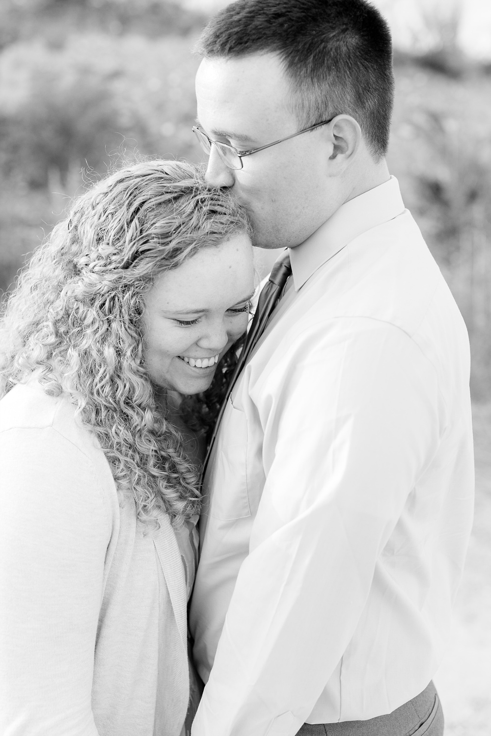 Minnesota Country Styled Engagement Pictures by Amber Langerud Photography | B&W couple snuggling