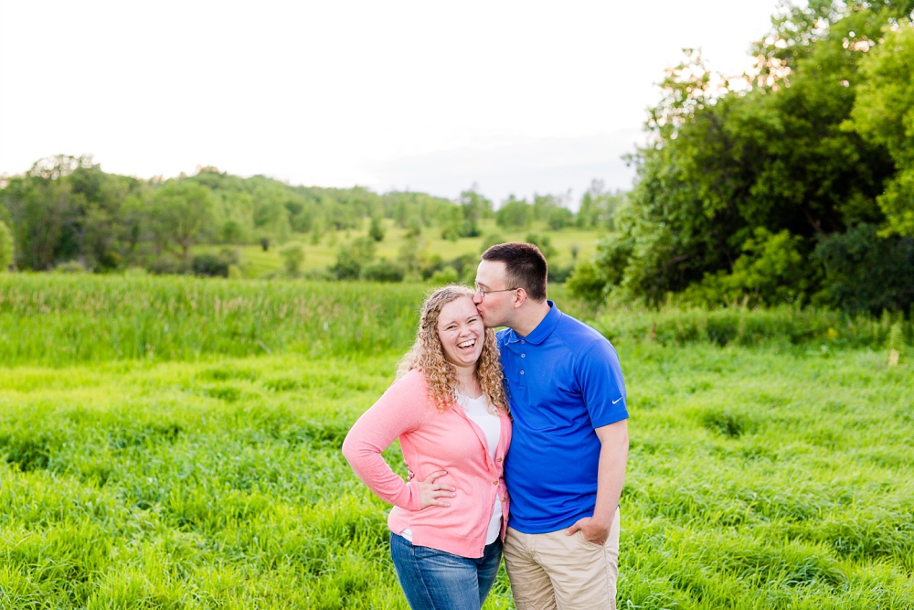 Minnesota Country Styled Engagement Pictures by Amber Langerud Photography | Couple laughing in grassy field