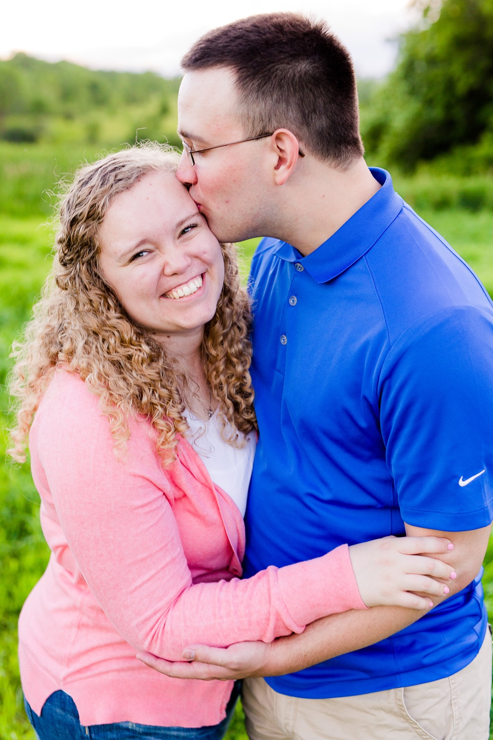 Minnesota Country Styled Engagement Pictures by Amber Langerud Photography | Happy couple wearing casual attire