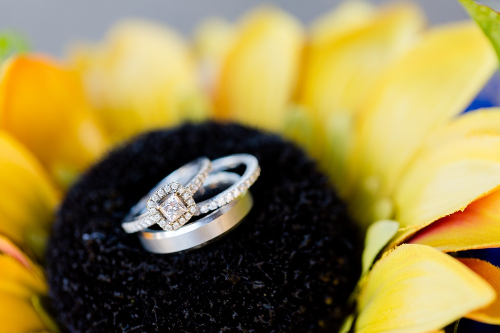 Detroit Lakes, MN Country Styled Wedding at Trinity Lutheran Church & Holmes Ballroom Photographed by Amber Langerud Photography | Wedding Rings in bouquet