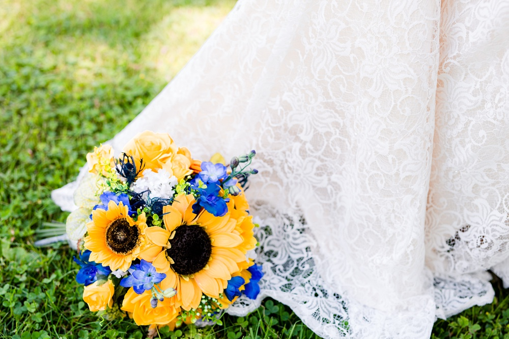 Detroit Lakes, MN Country Styled Wedding at Trinity Lutheran Church & Holmes Ballroom Photographed by Amber Langerud Photography | bouquet on bride's lacy dress
