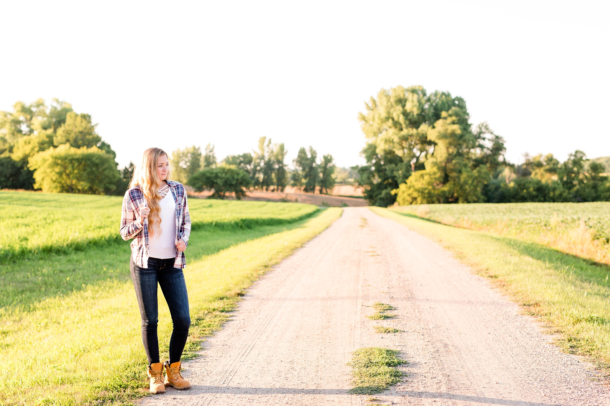 Country Styled High School Senior Pictures on a Farm and Little Cormorant Lake in Minnesota by Amber Langerud with Gravel Road