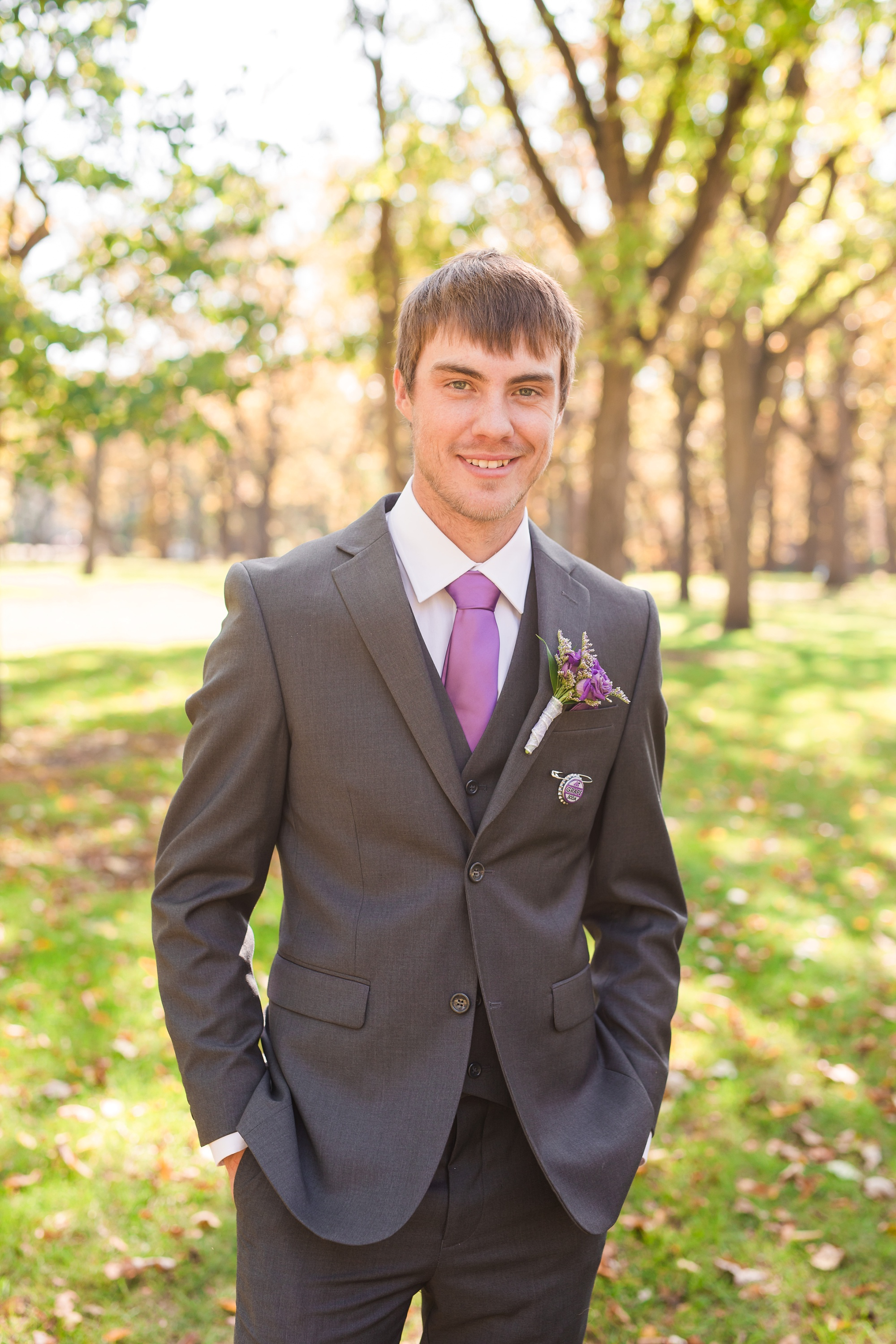 Downtown Fargo Disney Themed Wedding by Amber Langerud Photography | Groom Portrait Island Park