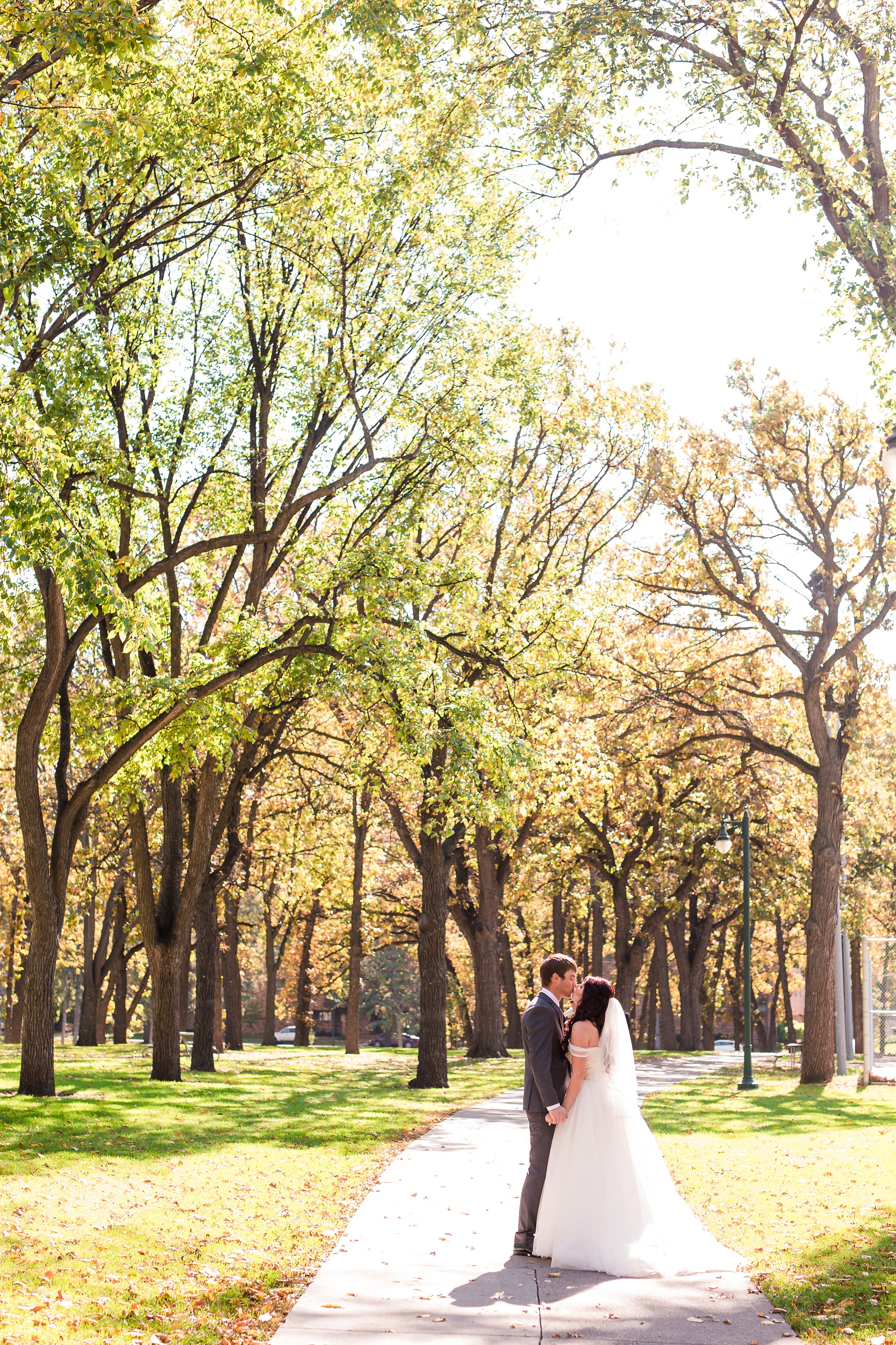 Downtown Fargo Disney Themed Wedding by Amber Langerud Photography | Bride & Groom Island Park