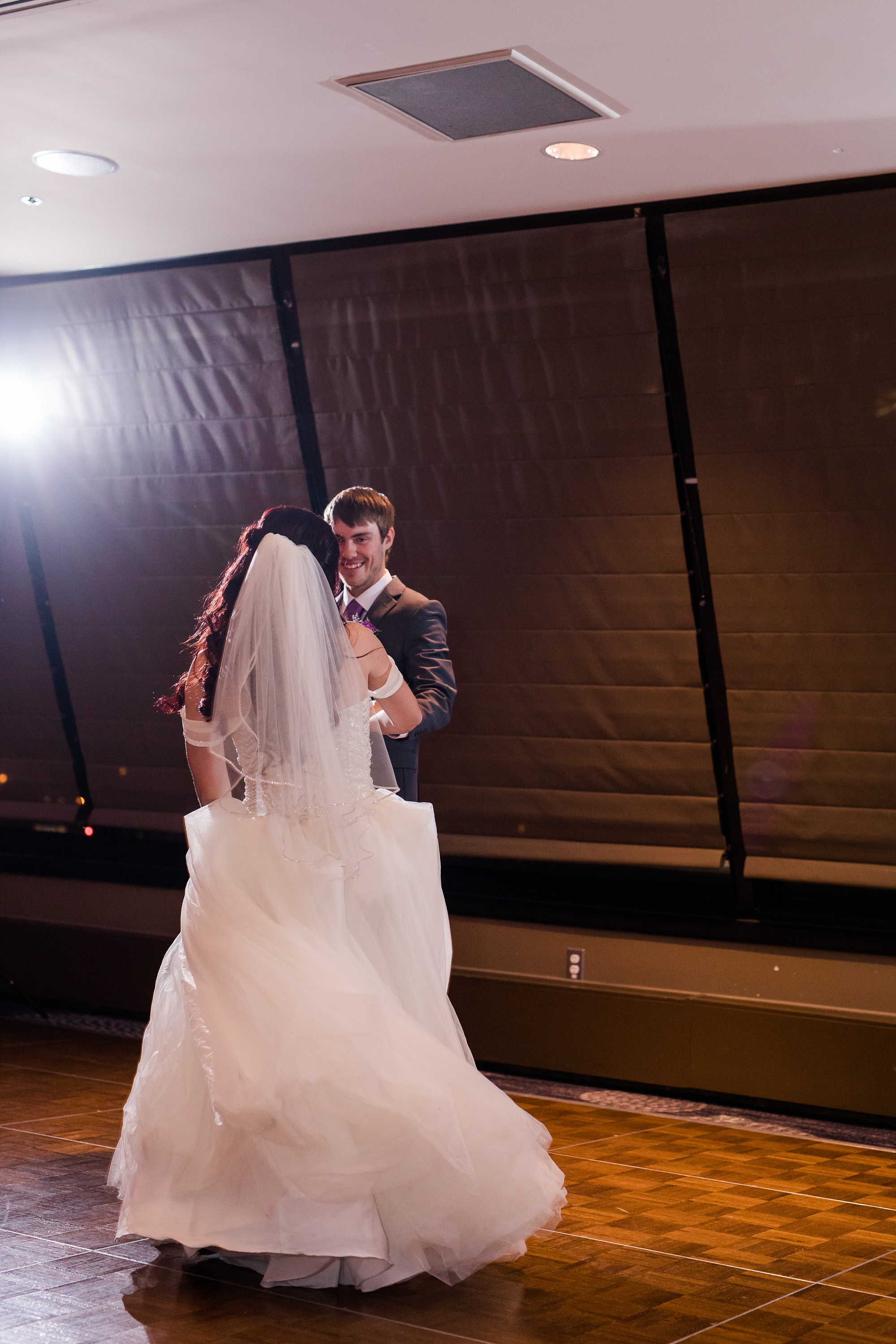 AmberLangerudPhotography_Downtown Fargo, ND Ramada Wedding_3705.jpg