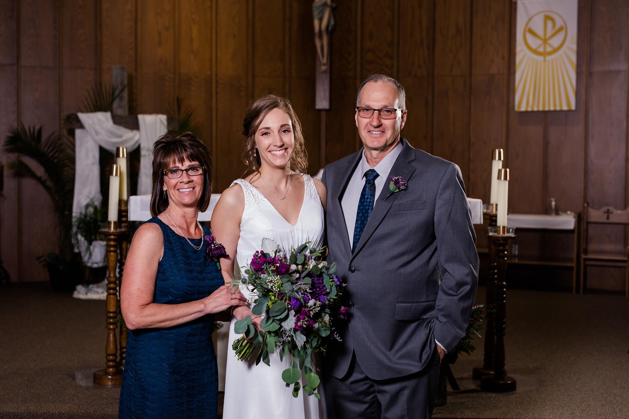 Amber Langerud Photography_Catholic Spring Wedding with Purple Accents_6322.jpg