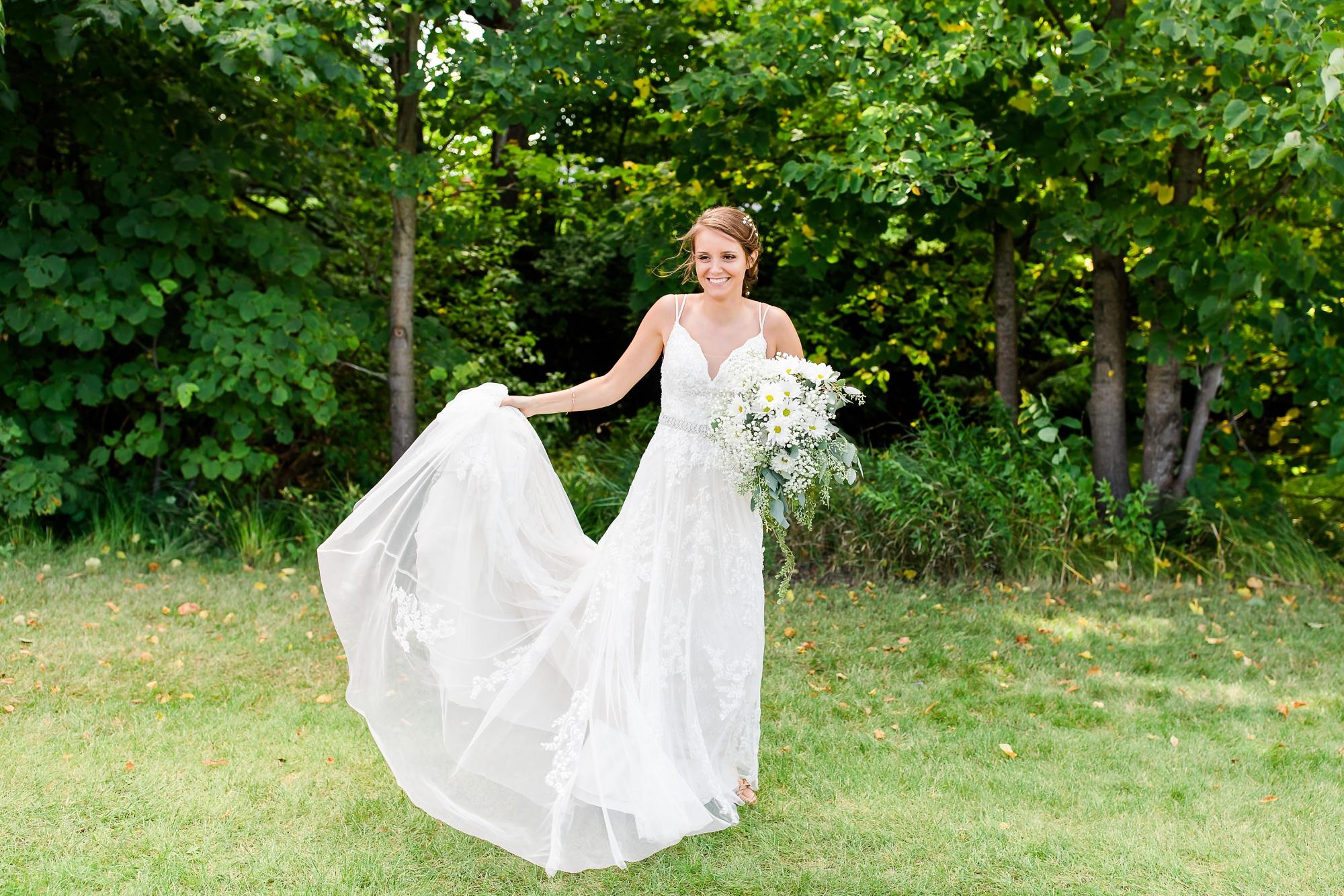 Amber Langerud Photography_Holy Rosary & Lakeside Detroit Lakes Wedding_6758.jpg