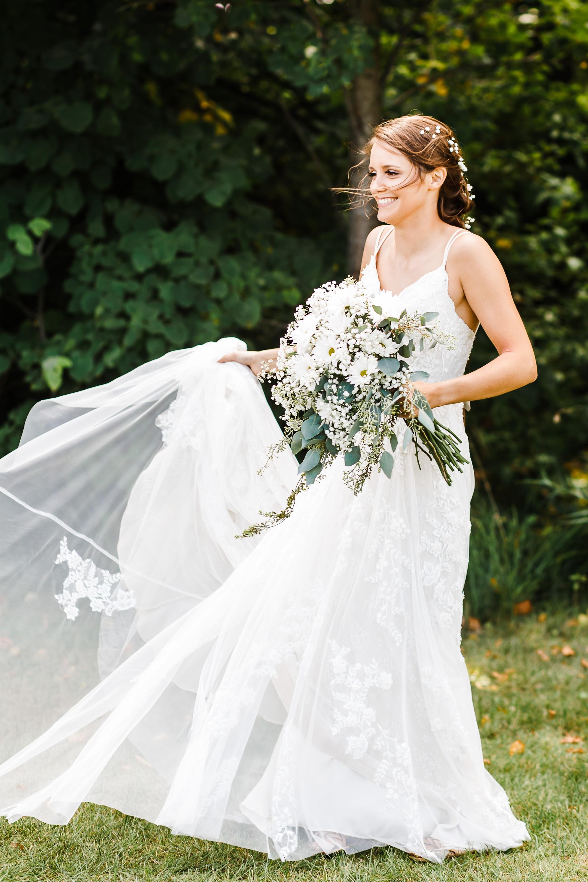 Amber Langerud Photography_Holy Rosary & Lakeside Detroit Lakes Wedding_6759.jpg