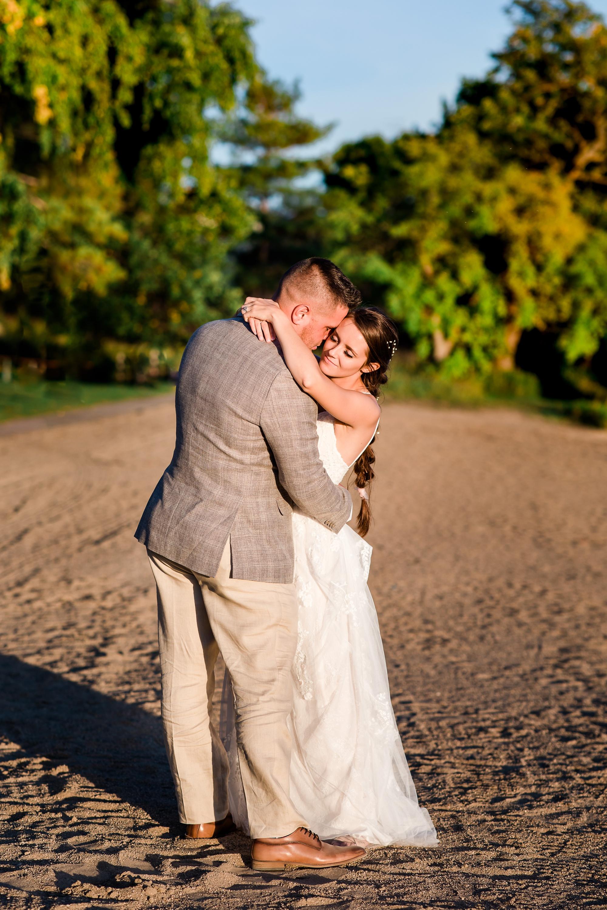 Amber Langerud Photography_Holy Rosary & Lakeside Detroit Lakes Wedding_6778.jpg