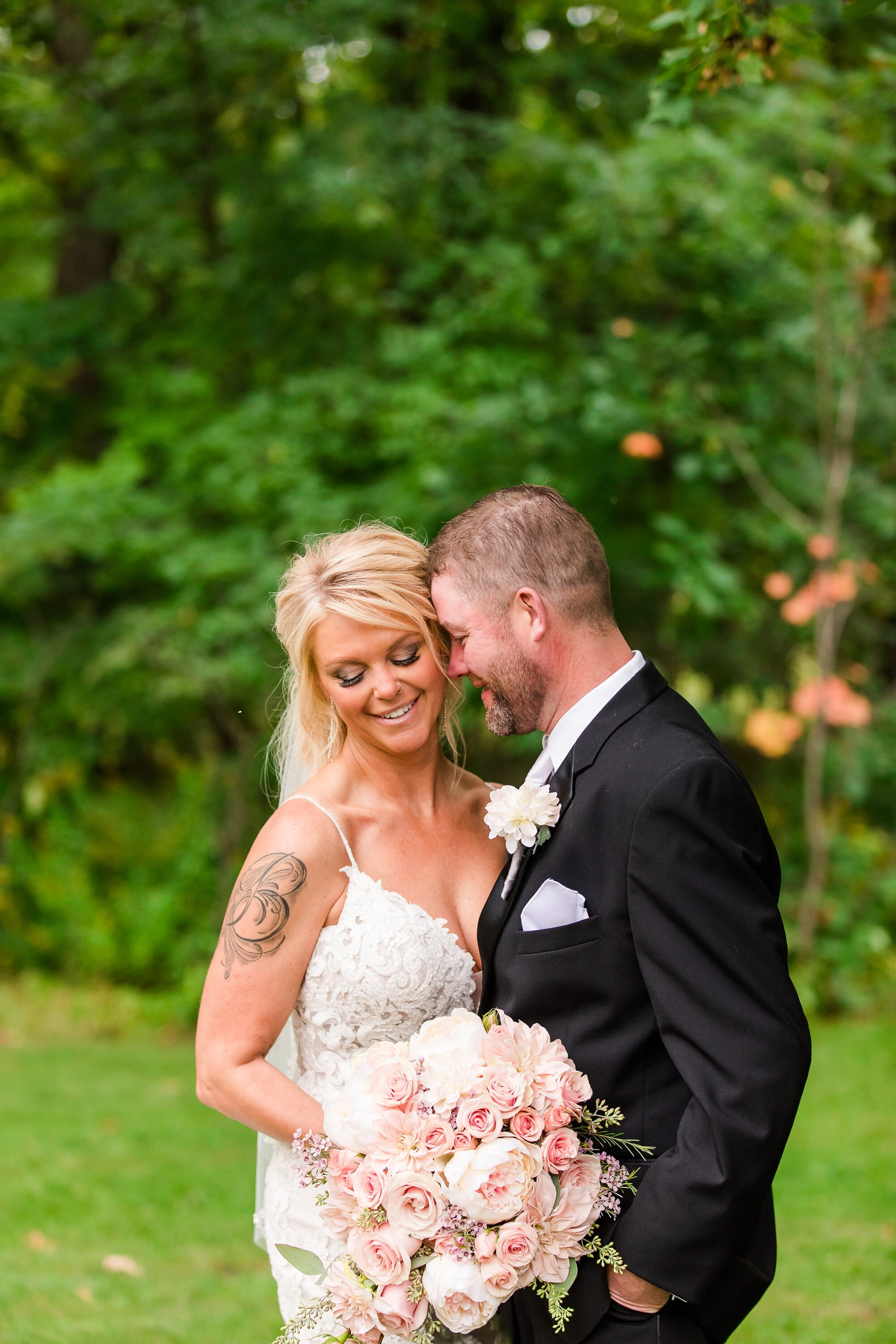 Amber Langerud Photography_Eagle Lake Rustic Styled Outdoor Wedding in Minnesota_6839-2.jpg