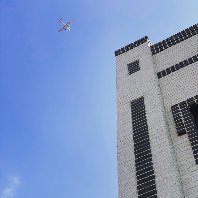 Saw this @americanair vintage plane flying over our building today.