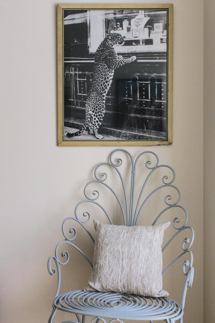 living room-scroll chair-cartier leopard.jpeg