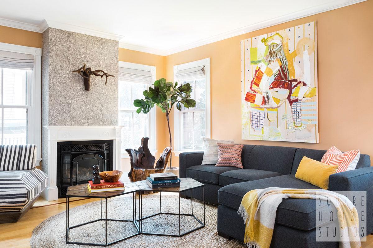 living-room-wide-navy-sofa-wallpaper-fireplace.jpg