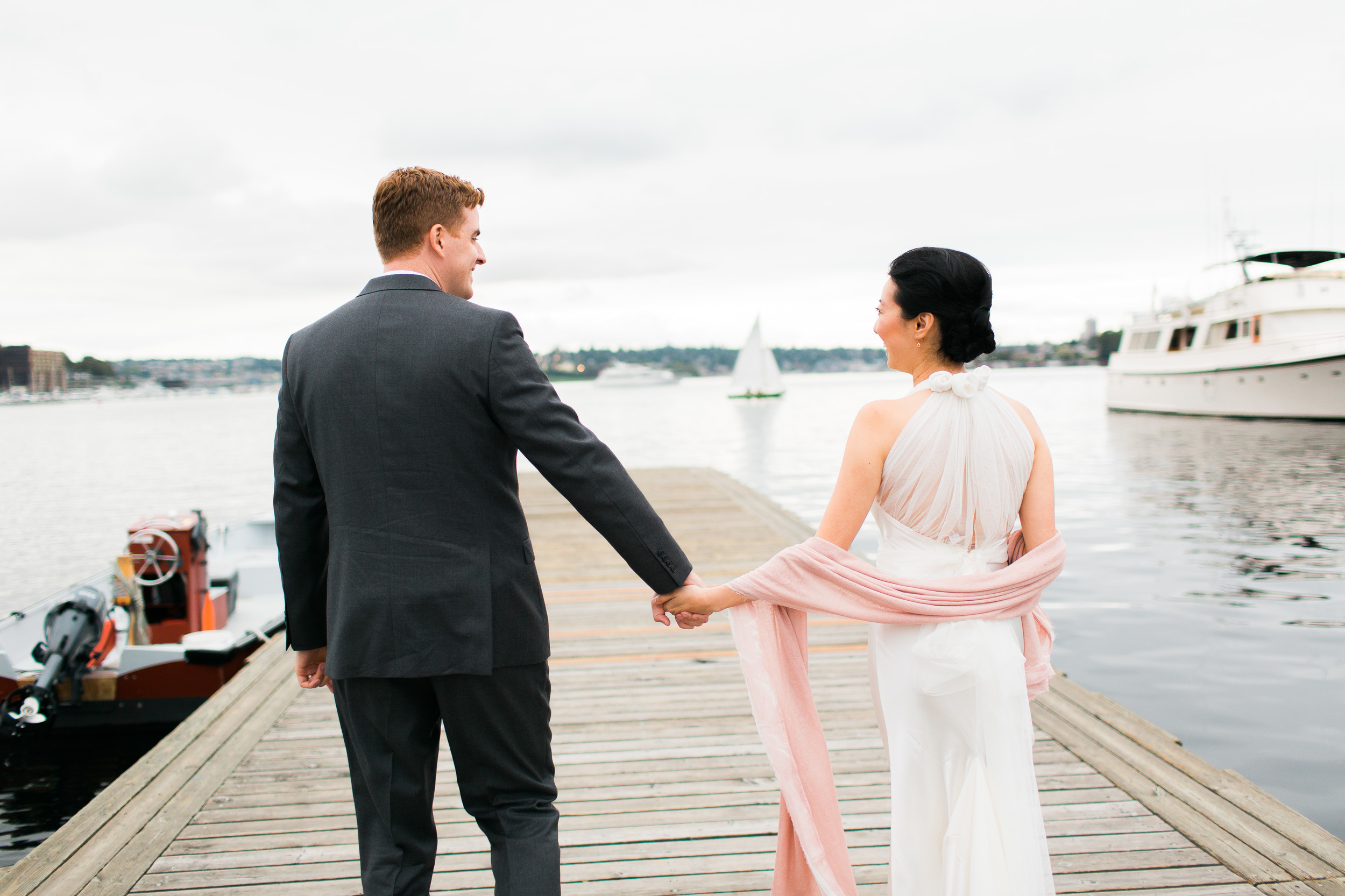 Bride and Groom on Dock   Center for Wooden Boats   Asgari Photography   Seattle Wedding Planner   Chinese Wedding Planner