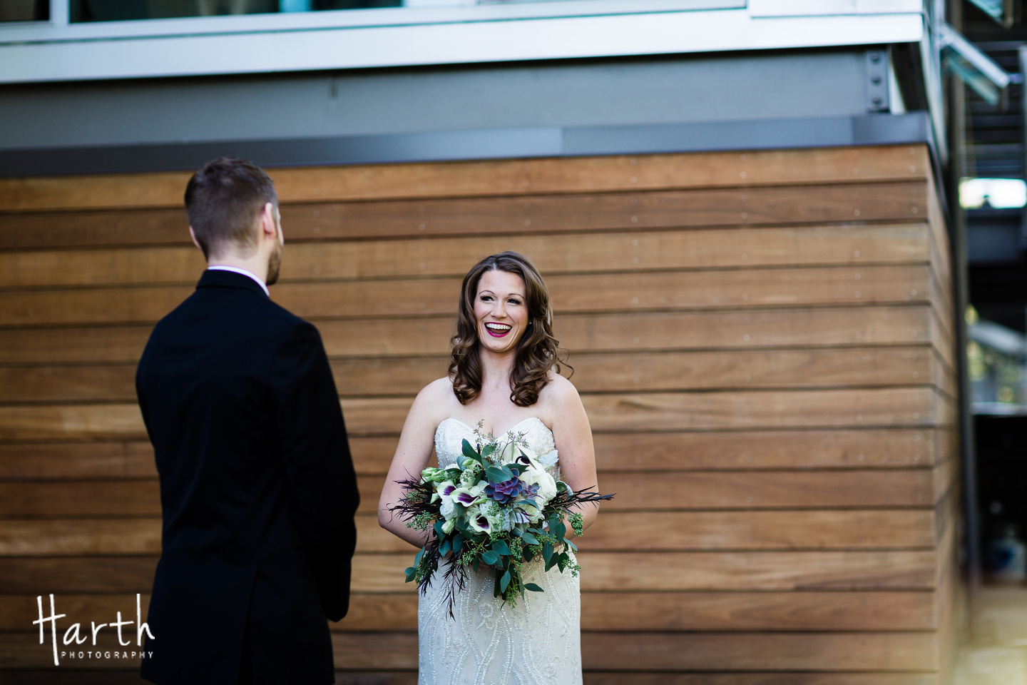 First Look Photo with Purple Calla Lilly Bouquet at Novelty Hill Januik Winery Wedding