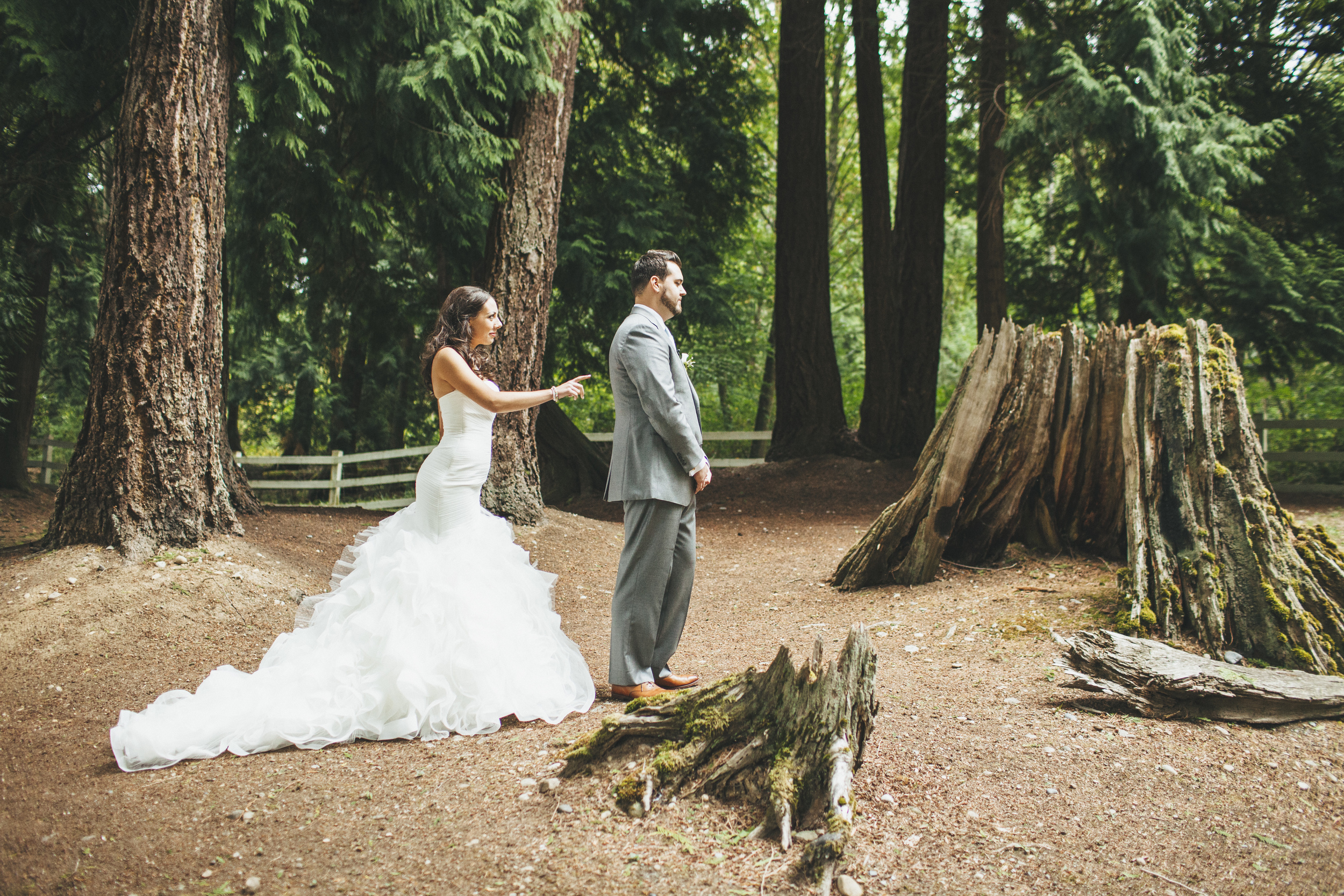 First Look Photo in a Ruffled Mermaid Style Wedding Gown