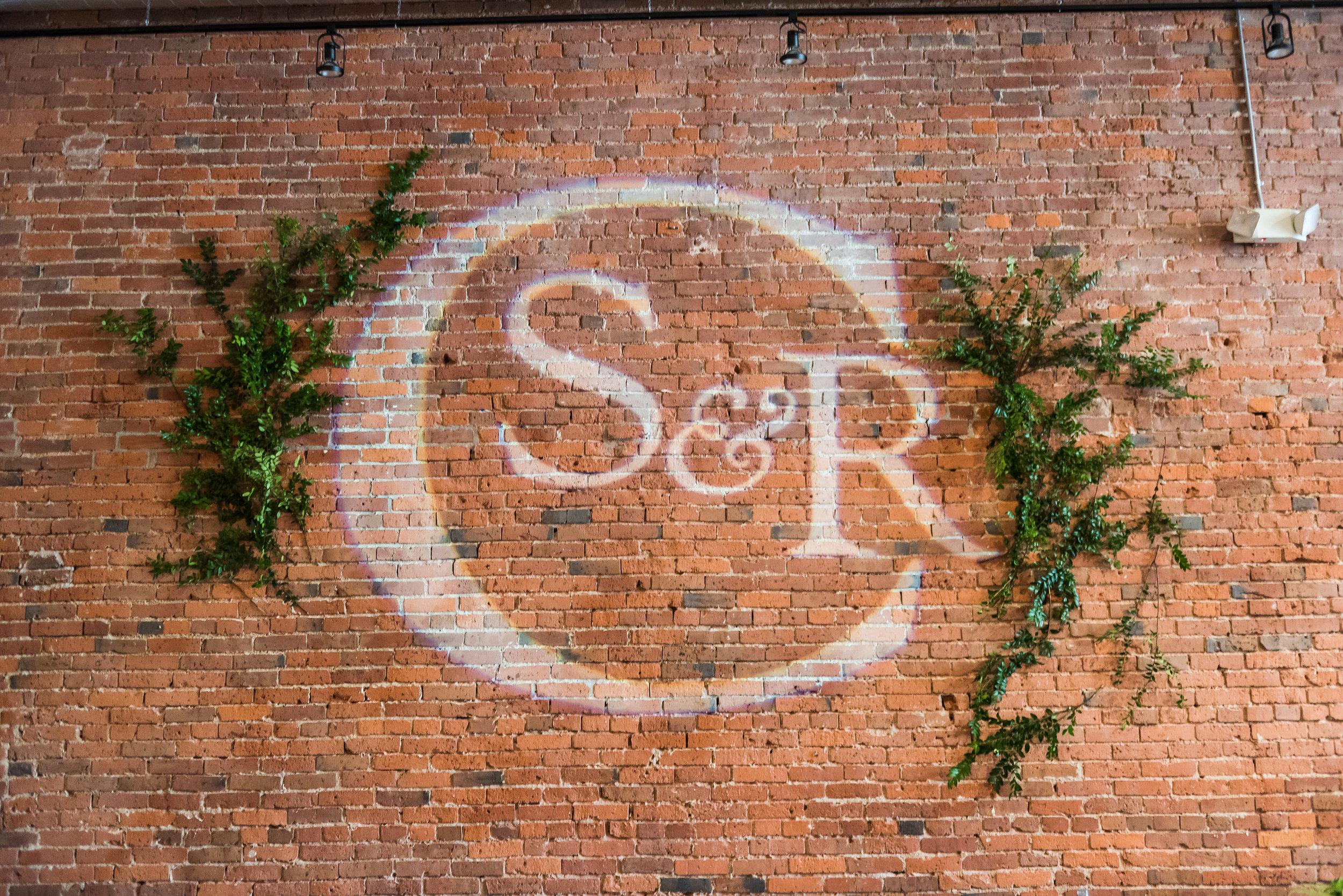 Gobo on wall with greenery.jpg
