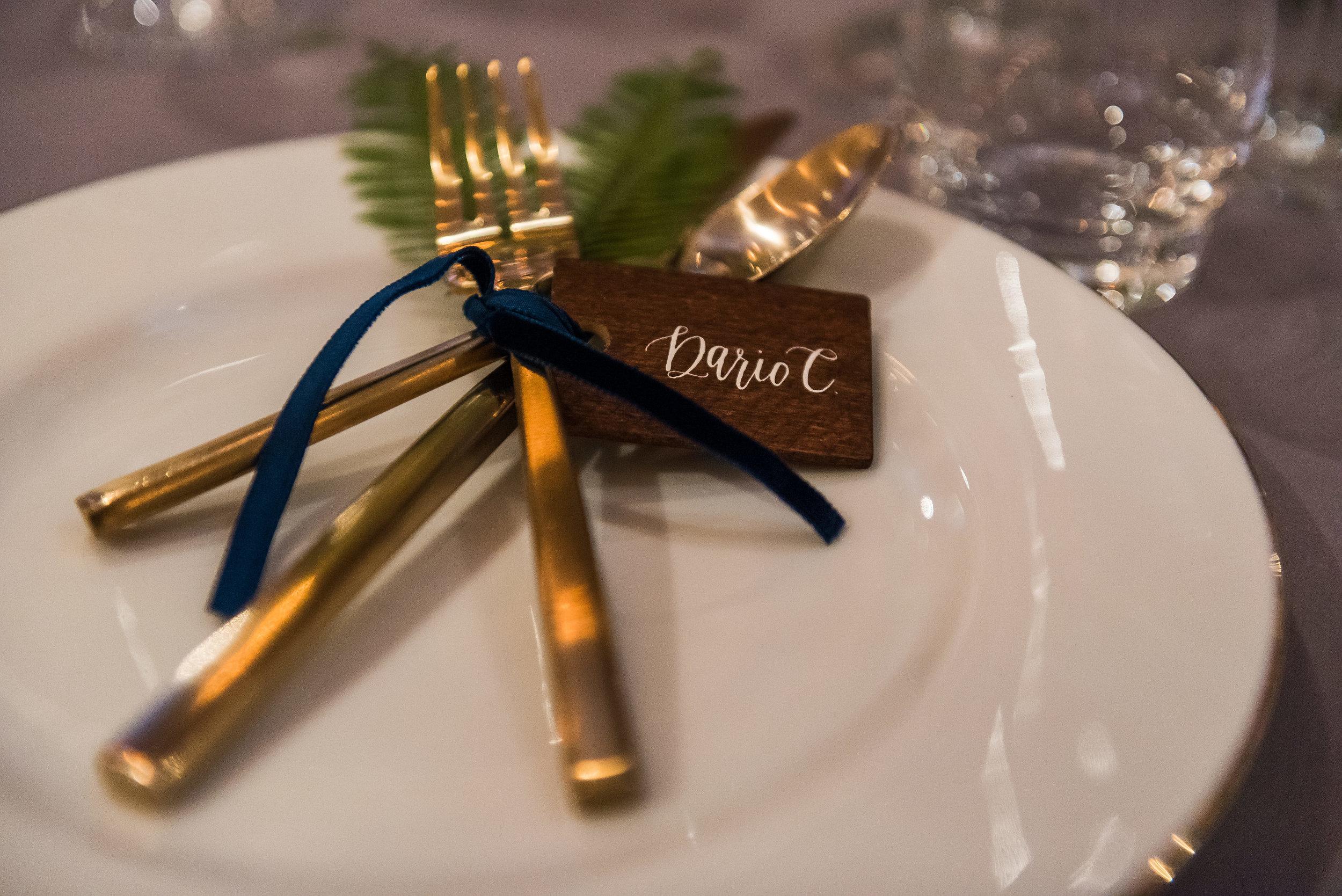 Gold siverware place setting with velvet ribbon wedding.jpg