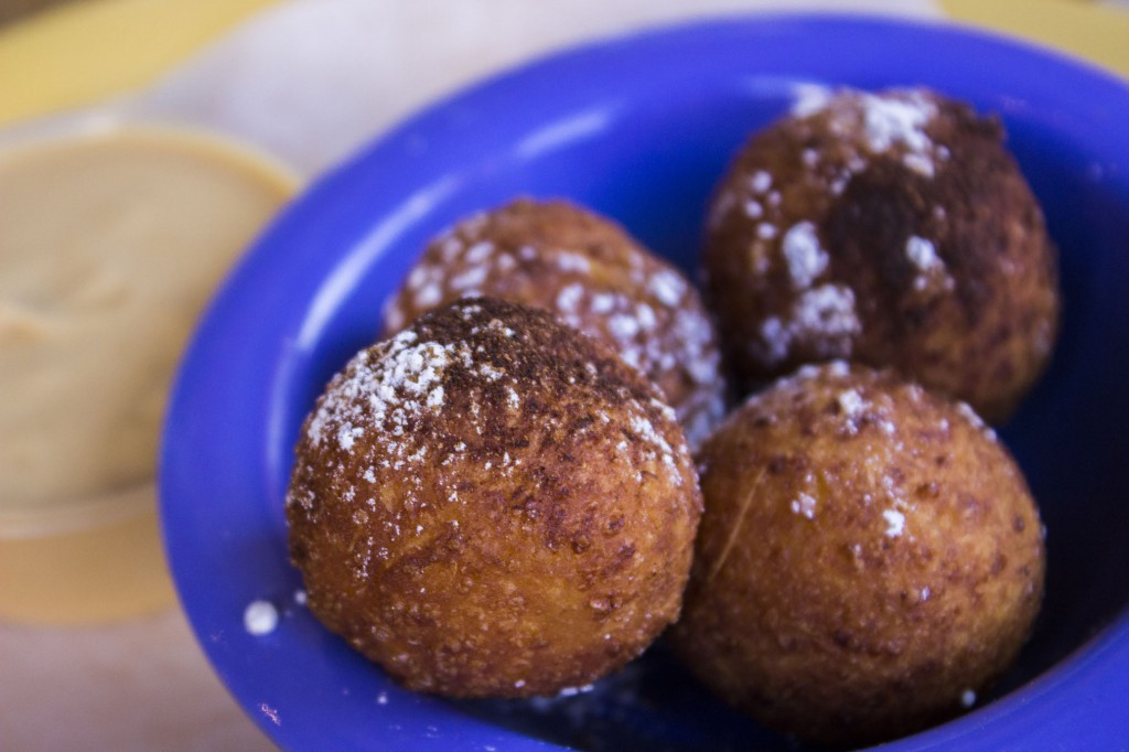 Quesco fresco stuffed yuca beignets. I HAVE to learn how to make these. Served with Dulce de leche.