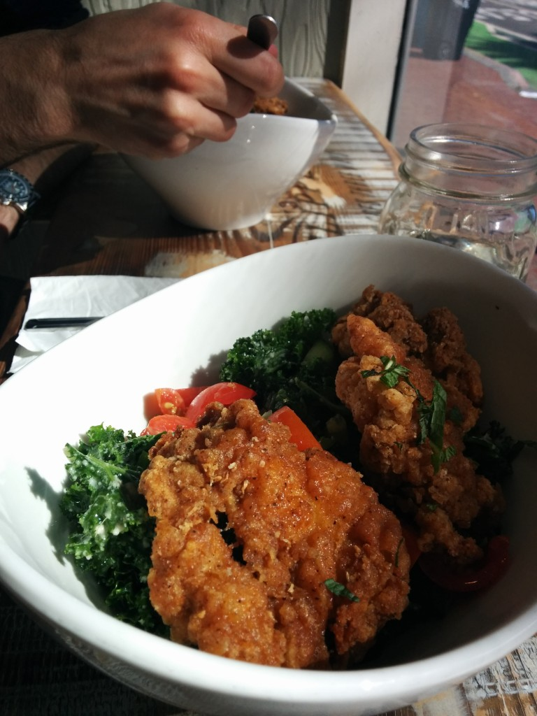 Fried chicken on the yummiest kale salad.
