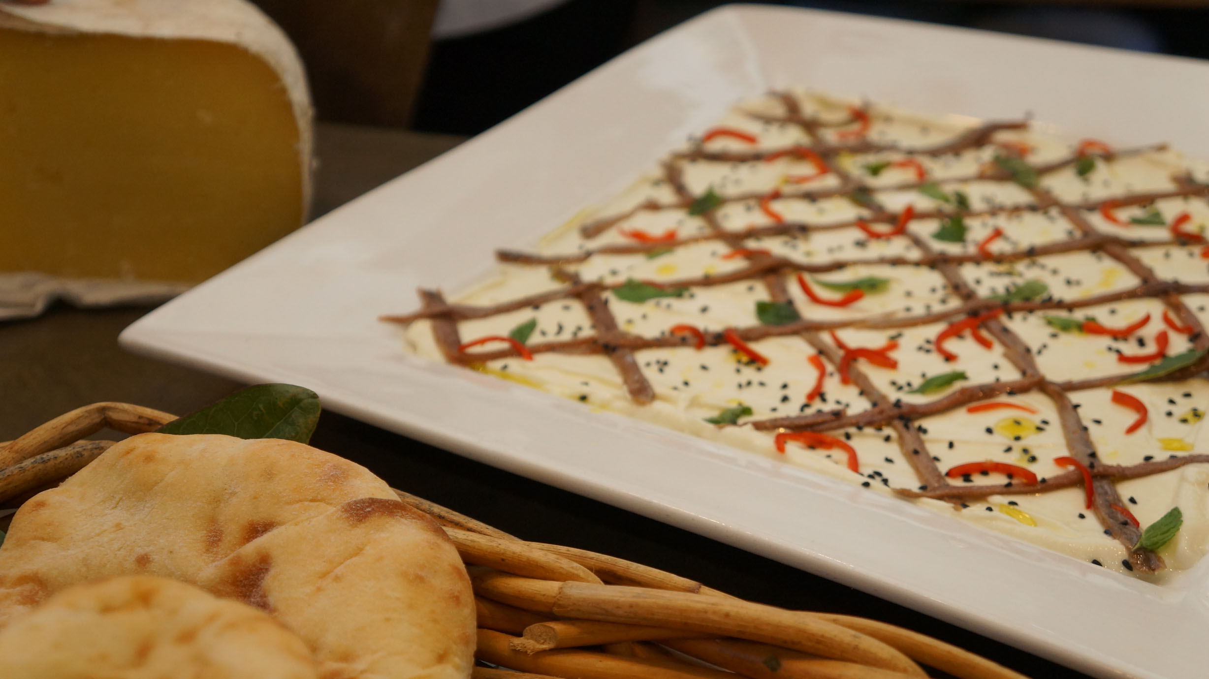 Labneh (strained yoghurt) with anchovies, chili, mint and pepper. DELISH