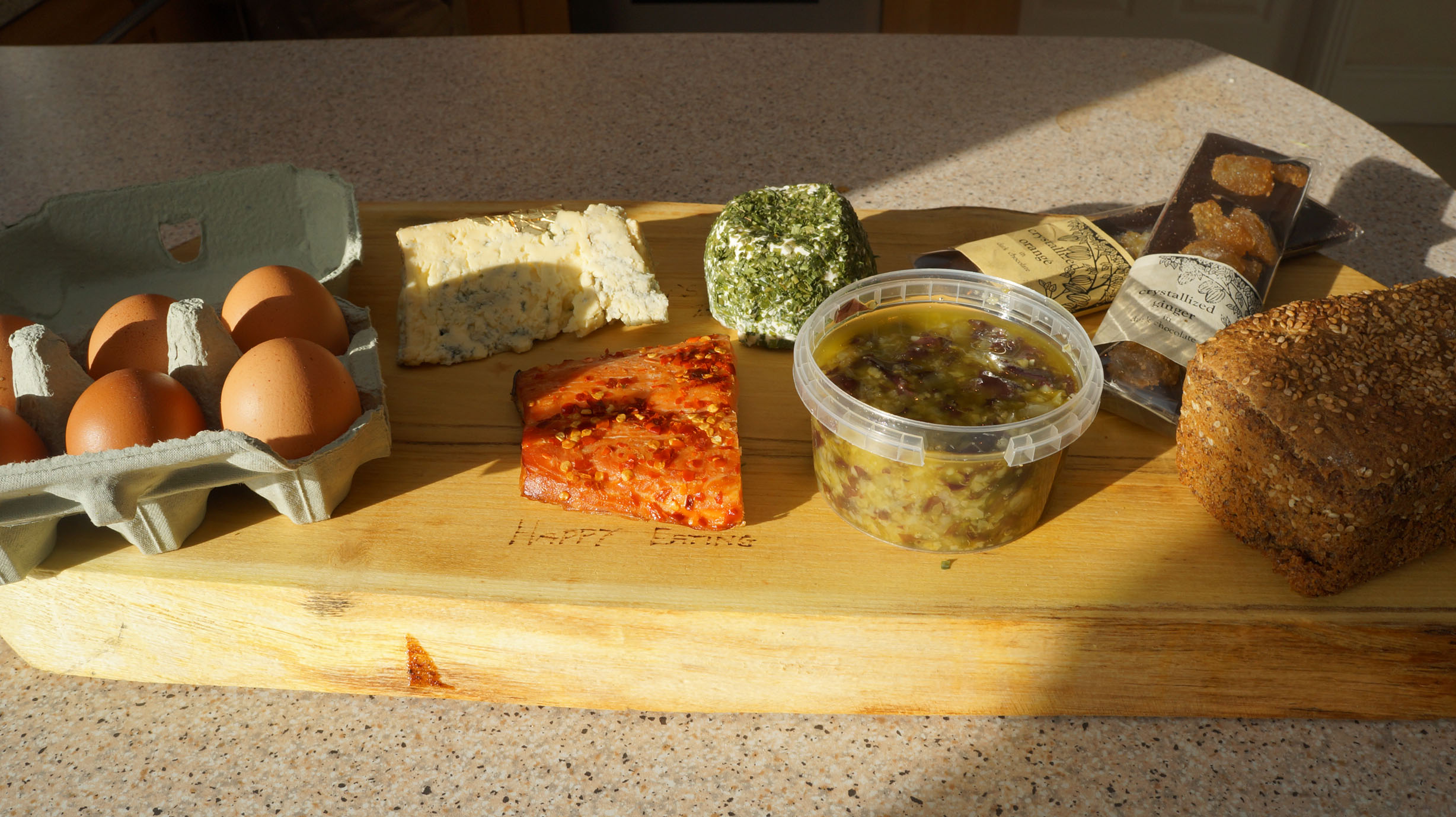 My goodies. Eggs, blue cheese, chive goat cheese, ginger dark chocolate, seaweed pickle, hot smoked salmon with chili.