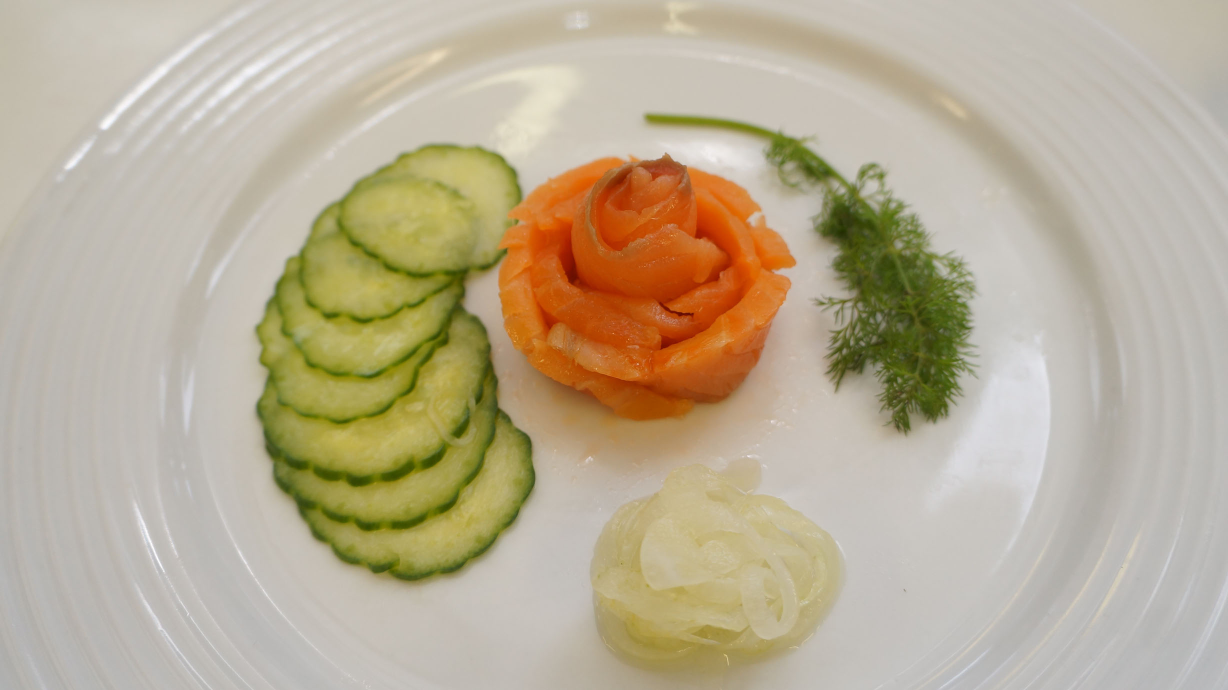 My creation!! Smoked salmon rosette with quick cucumber pickle.