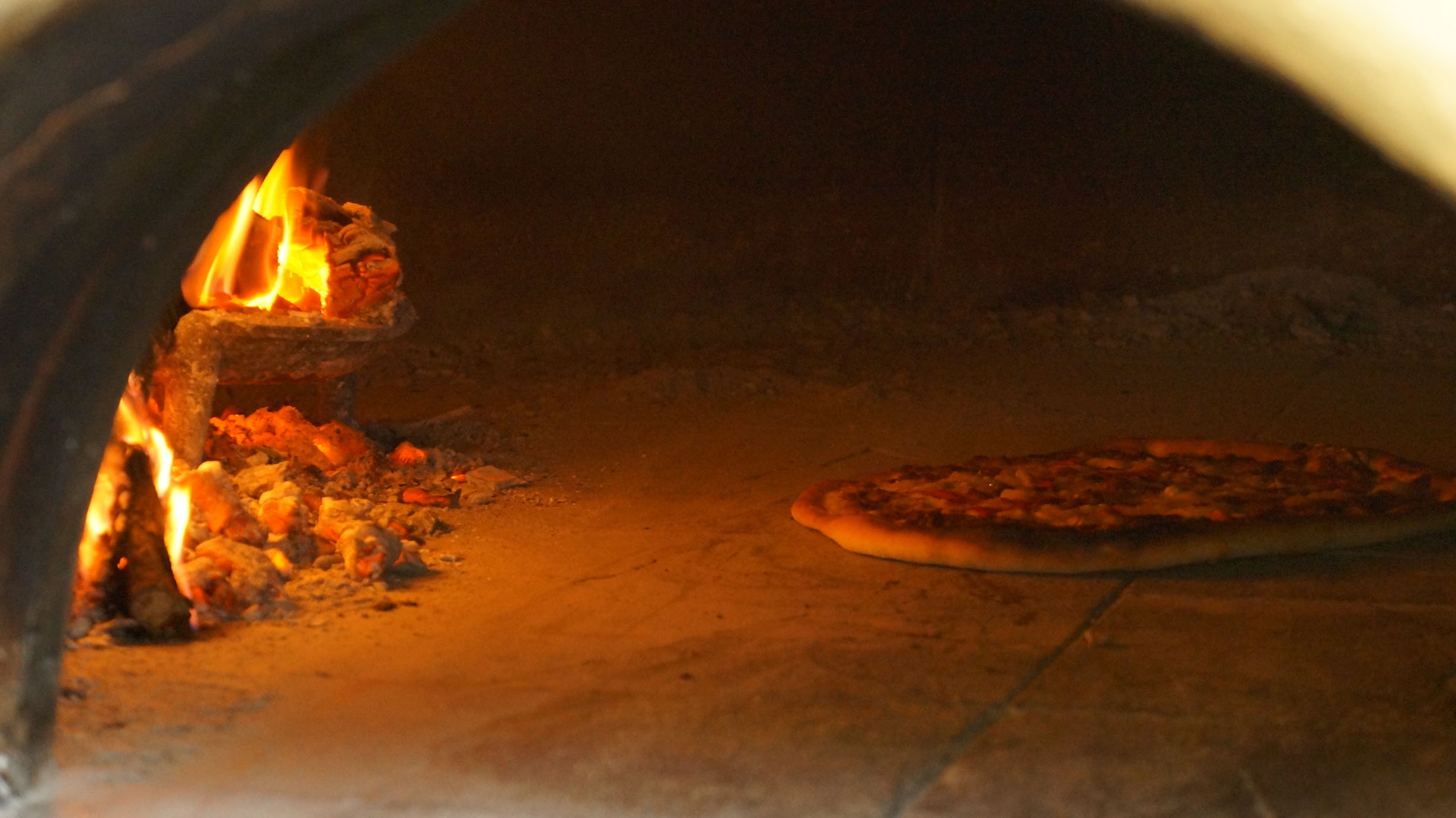 Wood-fired pizza made every Saturday at the school.