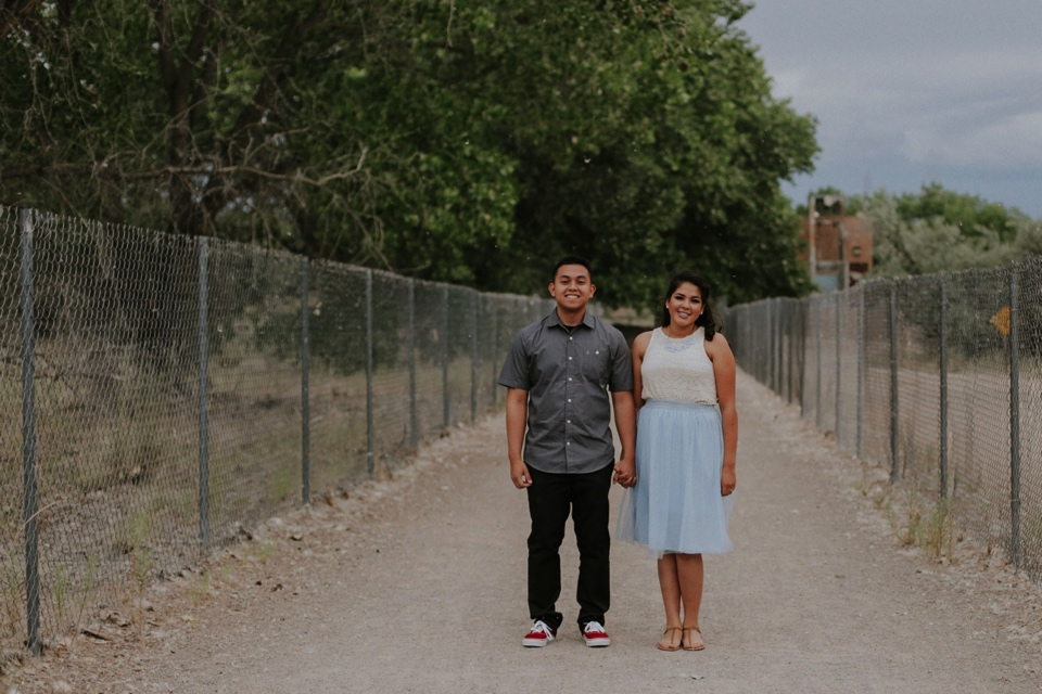 Isamar's adorable blue tulle skirt complimented Rafael's outfit perfectly and his red sneakers were the perfect pop of color! Their engagement session was filled with laughter, snuggles, and fun! We were also blessed with a beautiful New Mexico sunset which was the perfect ending to their engagement photo session.