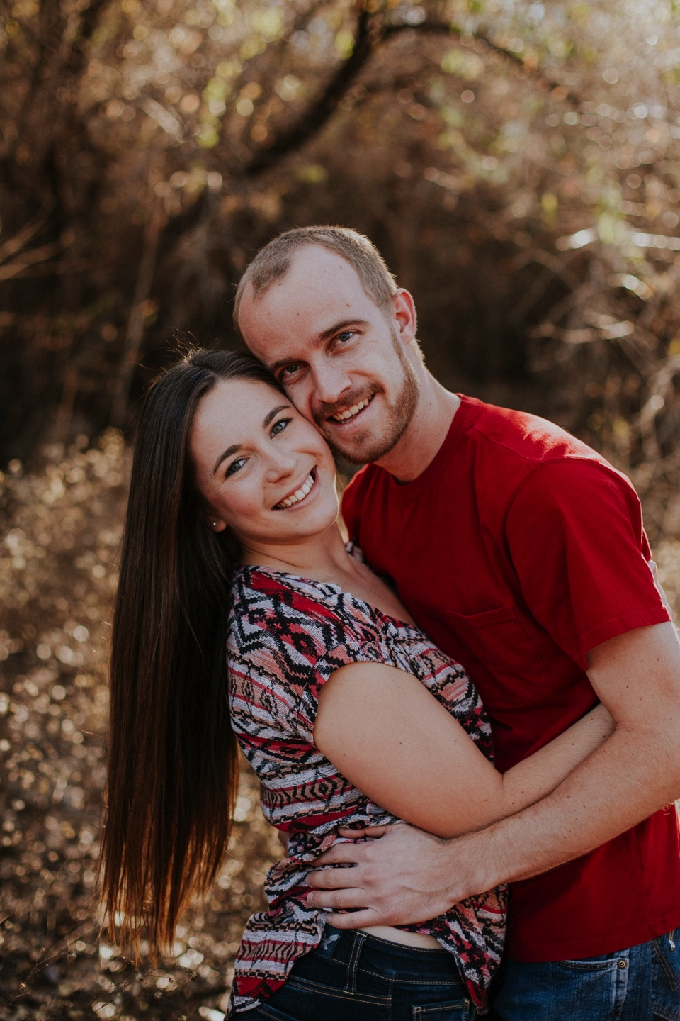 We met up again in Albuquerque, New Mexico and ventured to the Albuquerque bosque to take some fall inspired engagement photos. I loved the warm color palette they chose for their attire for this part of the session! We also had to take some cute engagement photo inspiration photos with the  Starbucks  red cups! <3