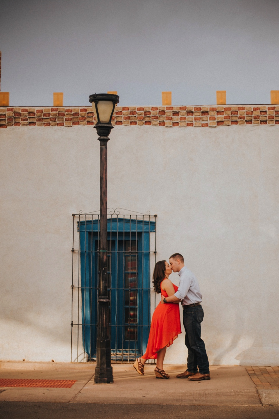 I loved Kristina's beautiful pink dress and Mitch's rustic yet classy outfit. Talk about engagement photo inspiration! We then traveled to Mesilla, New Mexico to capture their love fest in the La Plaza de Mesilla as well as in front of the Basilica San Albino Catholic Church. Mesilla is a gorgeous little town to capture engagement photos in and I had a blast with Kristina and Mitch (as well as their cute little corgi pup)!
