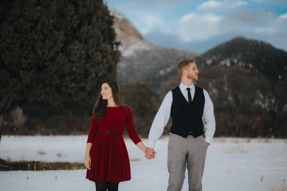 The Torres property is nestled beautifully in Arroyo Seco, New Mexico. Her family has quite a few animals that live on the property which are seriously so rad, but the view of the Sangre de Cristo mountains from there is INSANE. It's absolutely breathtaking! They also have a beautiful orchard that was a perfect backdrop for their stunning, snowy engagement photos (as well as a beautiful spot to tie the knot!).