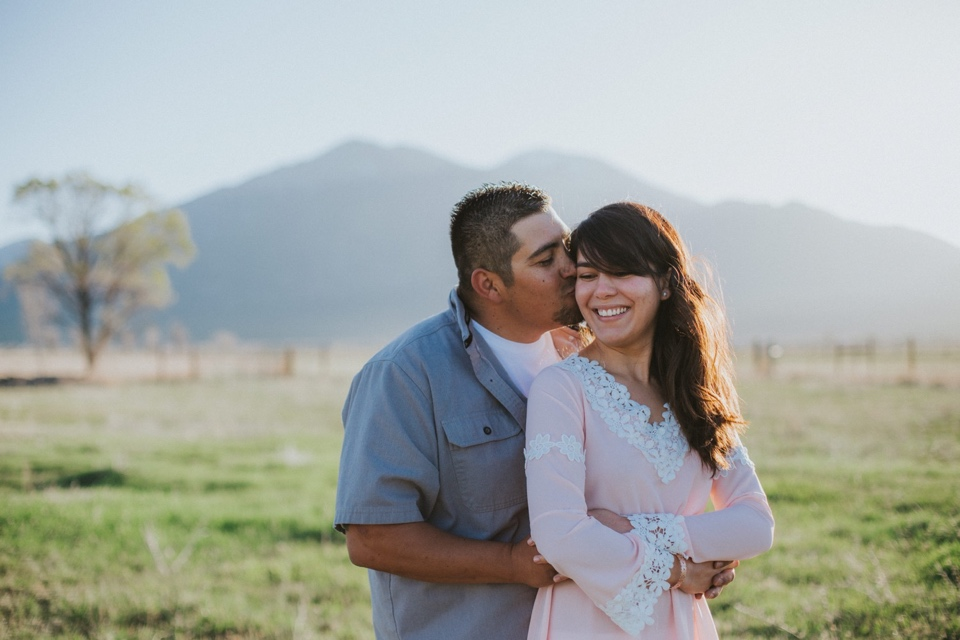 Spring in Taos, New Mexico is out of this world beautiful (especially because sometimes spring starts late due to the snow!). Mother Nature blessed us with a gorgeous spring morning for Jenea and Daniel's sunrise engagement session in Taos, New Mexico. The morning light rising above the Sangre de Cristo mountains is a beautiful sight to see especially from Overland Sheepskin Co. in Taos, New Mexico…