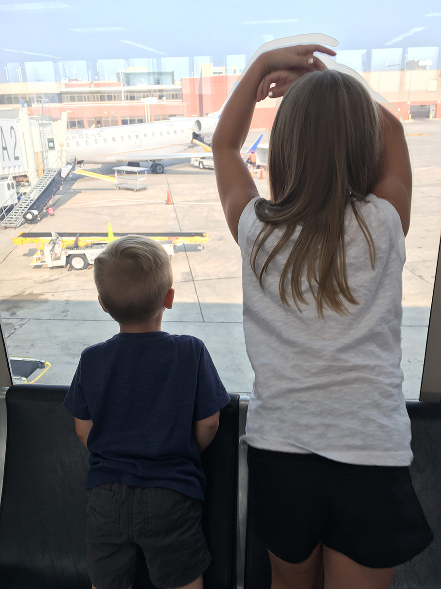 The kiddos are watching the first plane arrive.